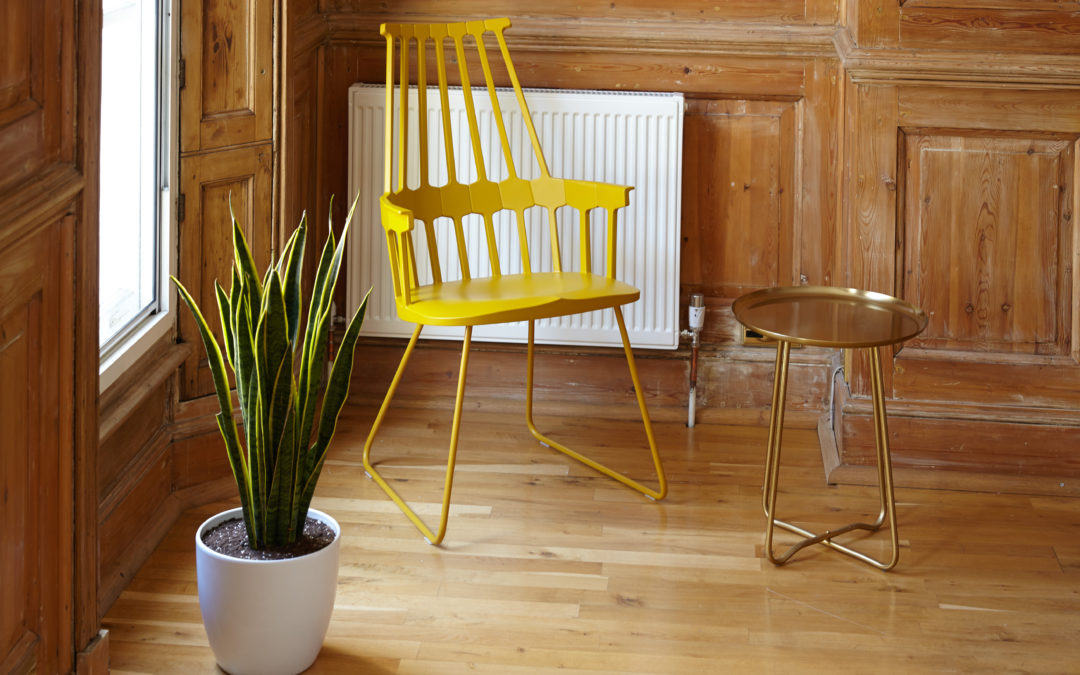 Yellow chair in wooden apartment