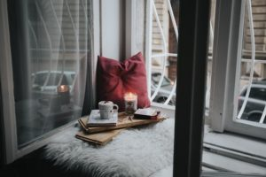 Apartment window with pillow and candles