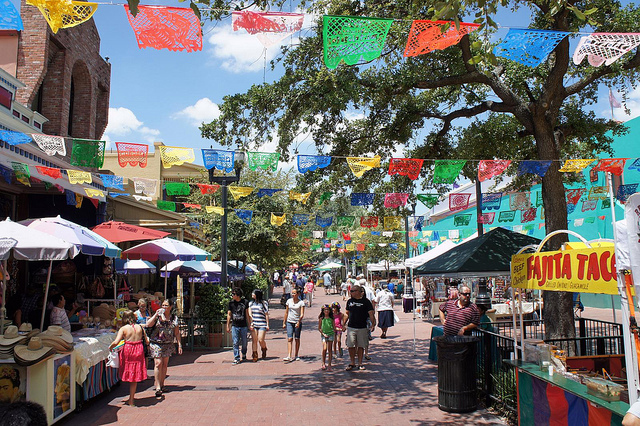 Colorful outdoor market in San Antonio with vendors